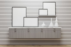 Room with drawers and posters, gray wall. Room with white stripes on gray wall. There are framed posters standing on a set of drawers and shelves. 3d rendering Stock Images