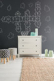 Room with dresser and rug. Room with dresser, rug, blackboard wall and upholstered stools stock images
