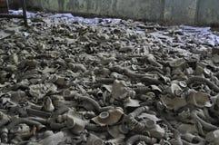 Room of dusty gasmasks Pripyat Chernobyl Ukraine stock photos