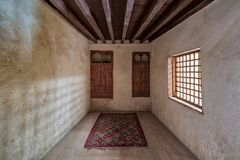Room at El Sehemy house, a historic old house with embedded wooden cupboard, wooden window and colorful carpet, Cairo, Egypt Stock Image