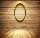 Room with elliptic frame. Light wooden room with empty elliptic frame Stock Photography