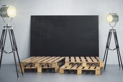 Room with empty blackboard banner and lighting Stock Photography