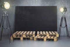 Room with empty chalkboard billboard and lighting Stock Photo