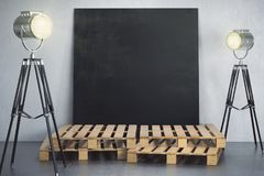 Room with empty chalkboard poster and lighting Royalty Free Stock Images
