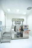A room with an equipment for pill production Stock Photography