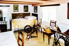 Room in farmhouse 19th century. Spinning wheel Royalty Free Stock Photos