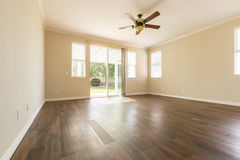 Room with Finished Wood Floors and Ceiling Fan Stock Photos
