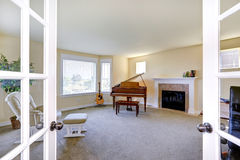 Room with fireplace, grand piano and guitar Royalty Free Stock Image