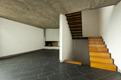 Room fireplace and wooden staircase Royalty Free Stock Image