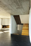 Room fireplace and wooden staircase Stock Image