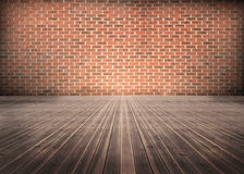 Room of floorboards with bricks wall. Empty room of floorboards with bricks wall Royalty Free Stock Photo