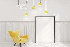 Room with a framed vertical poster and a yellow armchair Royalty Free Stock Images