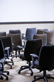 Room full of empty office chairs Stock Photos