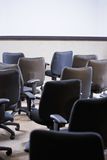 Room full of empty office chairs. Rear view royalty free stock photos