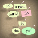 In Room Full of No Be the Yes Saying Quote Words. The words In a Room Full of No Be the Yes saying pinned on a bulletin board Royalty Free Stock Images