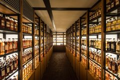 Room full of whisky cabinets storing different types of whiskey.  Stock Photos