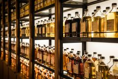 Room full of whisky cabinets storing different types of whiskey.  Stock Photography