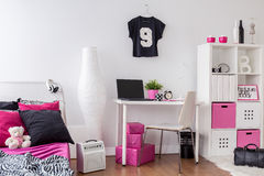 This room is so girly. Bedroom and study room combined, decorated in pink, white and black Stock Image