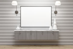 Room with gray drawers, lamps, poster, gray wall Royalty Free Stock Image