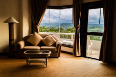 Room with great views. PHETCHABUN,THAILAND - July 19,2016 : the room in resort with wind turbines on mountain Royalty Free Stock Photography