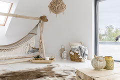 Room with hammock. White room with hammock, window and wooden accessories Royalty Free Stock Photos