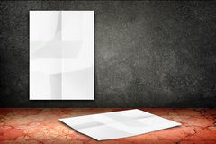 Room with hanging blank crumpled white poster at black stone wal Royalty Free Stock Photography