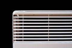 Room heater and radiator. Closeup on black background Stock Image