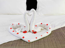 Room in a hotel with swans from the towel on the newlyweds bed Royalty Free Stock Photos