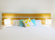 Room interior with bed and bright modern cushions Royalty Free Stock Photo
