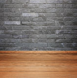 Room interior with brick stone tiles wall and wood floor backgro Royalty Free Stock Images
