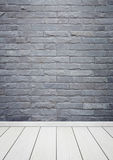 Room interior with brick stone tiles wall and wood floor backgro Stock Photography