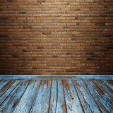 Room interior with brick wall and wood floor Stock Photos