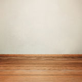 Room interior with concrete wall and brown wood floor Stock Image