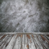 Room interior with concrete wall (Loft style) and wood floor bac Royalty Free Stock Photos