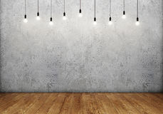 Room interior with empty concrete wall, retro light bulbs and wooden floor Stock Images