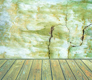 Room interior: green damaged cement wall with wooden floor Stock Image