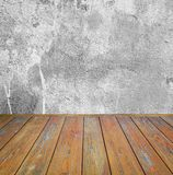 Room interior: grey cement wall with brown wooden floor Stock Photo