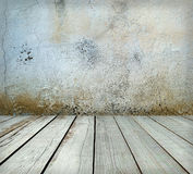 Room interior: grey old painted cement wall with wooden floor Royalty Free Stock Photos