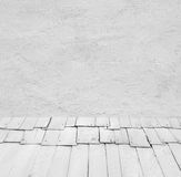 Room interior: grey old painted cement wall with wooden floor Royalty Free Stock Images