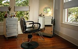 Modern beauty salon. Room Interior in modern beauty salon with morrow reflections stock image