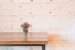 Room interior white brick wall with wooden table Royalty Free Stock Image
