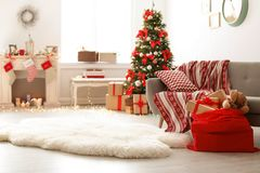 Free Room Interior With Christmas Tree And Santa`s Bag Stock Image - 124720251