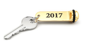 Room key with golden keychain 2017 new year. Concept isolated on white Stock Photo