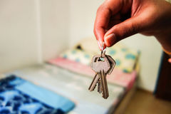 Room key handing over. Concept can be used for house renting lodging stay etc Royalty Free Stock Photography