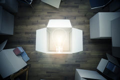 Room with lamp inside box. Top view of room with cardboard boxes and abstract light bulb. Idea concept. 3D Rendering Royalty Free Stock Photo