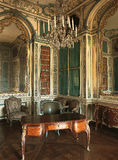 Room with large mirror, chandelier and furniture at Versailles Palace. Versailles, France - 13 August 2014 : Room with large mirror, chandelier and furniture at royalty free stock image