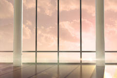 Room with large windows showing sunrise Stock Photo