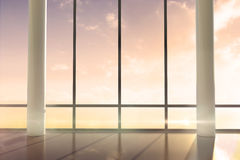 Room with large windows showing sunrise Royalty Free Stock Photos