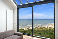 Room with large windows and view on seaside Royalty Free Stock Photo