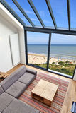 Room with large windows and view on seaside Royalty Free Stock Image